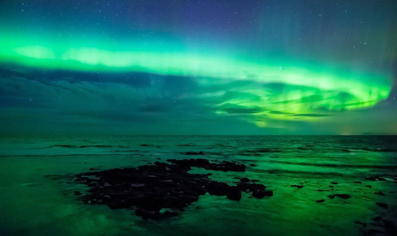 aurora-borealis-over-the-sea-gardur-iceland